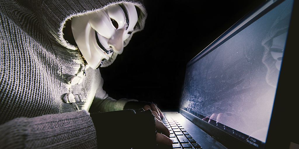 Hacker at work on his computer